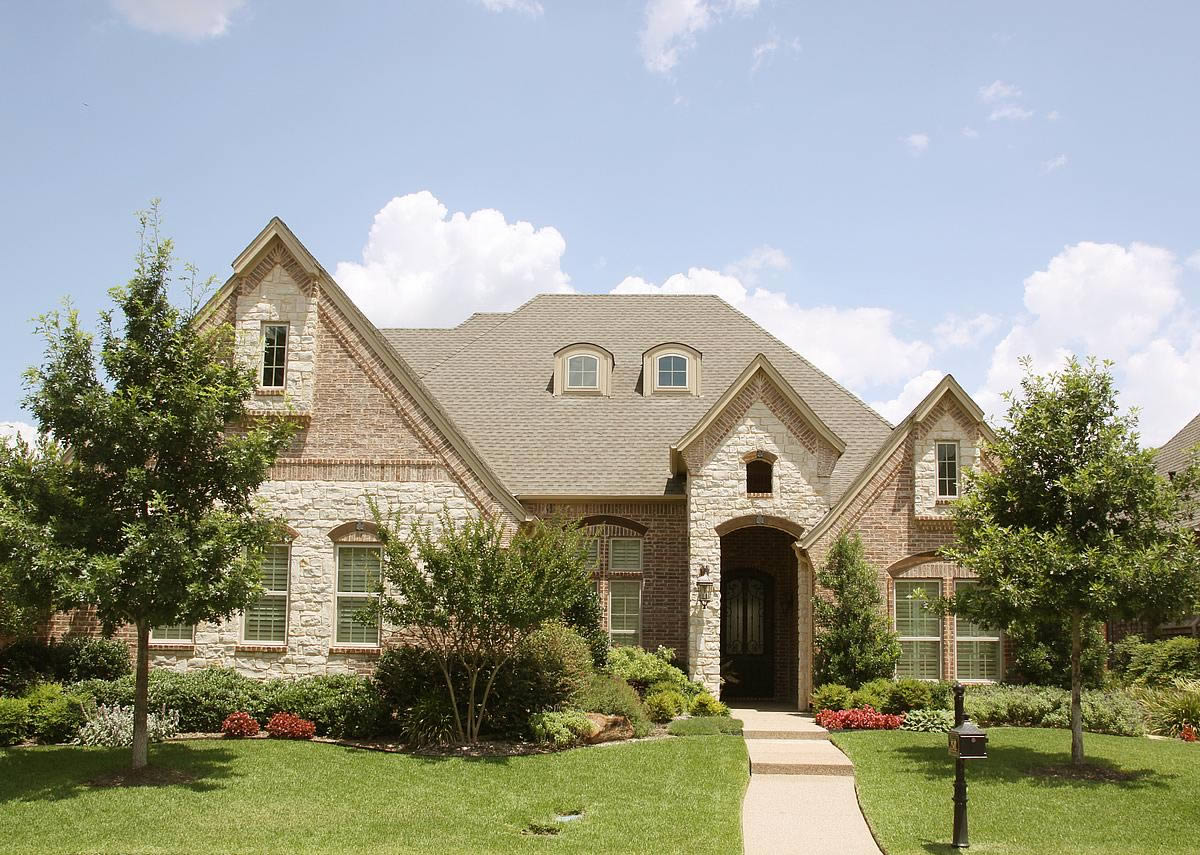 Traditional exteriors compass custom homes for Luxury traditional homes